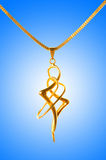 Golden jewellery against gradient Stock Image