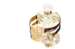 Golden jewellery and perfume royalty free stock photography