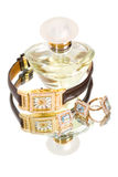 Golden jewellery and perfume stock photography