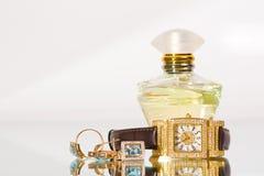 Golden jewellery and perfume stock photos