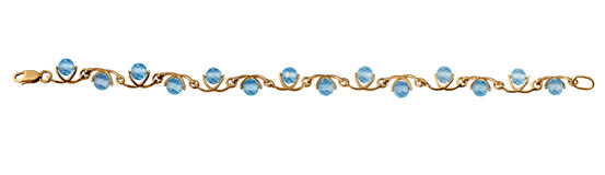 Golden jewelry bracelet with blue topaz Royalty Free Stock Images