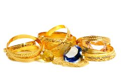 Golden jewelry royalty free stock images