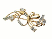 Golden jewelry brooch Royalty Free Stock Photo