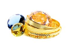 Golden jewelry and diamonds stock photography