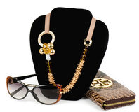 Golden jewelry, glasses and handbag Royalty Free Stock Image