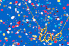 Golden Jewelry Necklace with Love Sign. 3d Rendering. Golden Jewelry Necklace with Love Sign on an abstract background. 3d Rendering Royalty Free Stock Photos