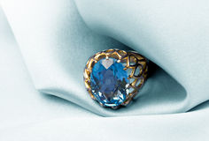 Golden jewelry ring with blue topaz Stock Photo
