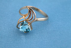 Golden jewelry ring with blue topaz Royalty Free Stock Photo