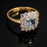Golden jewelry ring with sapphire and brilliants Stock Photos