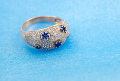Golden jewelry ring with sapphires Stock Photos