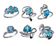 Golden jewelry rings with blue topaz royalty free stock images