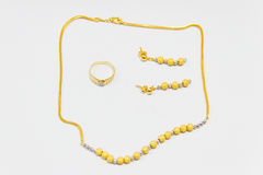 Golden jewelry set Royalty Free Stock Photos