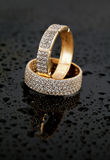 Golden jewelry two rings stock image