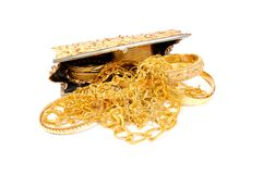 Golden jewels on white royalty free stock photography