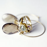 Golden Jewlery. Golden ring and earrings against white background stock photos