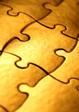 Golden jigsaw Royalty Free Stock Photos