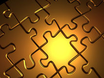 Golden jigsaw puzzle Stock Images