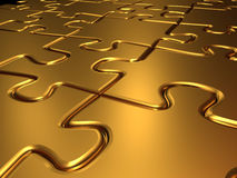 Golden jigsaw puzzle Royalty Free Stock Image