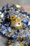 Golden jingle bell with blue and yellow Royalty Free Stock Photography