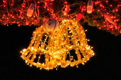 Golden jingle bell on Christmas tree Royalty Free Stock Photo