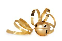 Golden jingle bell with curled ribbon Royalty Free Stock Images