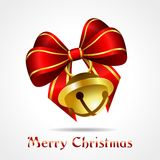 Golden jingle bell with red ribbon Stock Photography