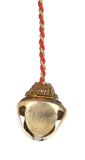Golden jingle bell on a rope. Royalty Free Stock Photography