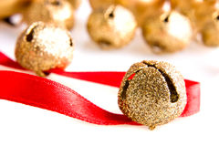 Golden jingle bells. With red ribbon Royalty Free Stock Photo