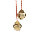 Golden jingle bells on a rope. Stock Photo