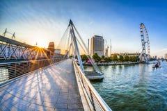 Golden Jubilee Bridge against sunrise in London, England, UK Stock Images