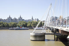 Golden Jubilee bridge and support on river Thames Stock Photos