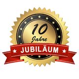 Jubilee medallion - 10 years. Golden jubilee medallion with red banner for 10 years stock illustration