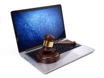 Golden judge gavel on laptop Royalty Free Stock Photos