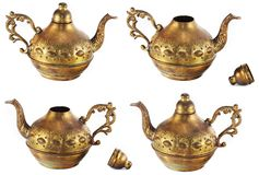 Golden kettle with engravings. (view from different angles) isolated on white background Royalty Free Stock Photos