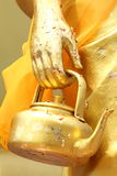 Golden Kettle in The Hand of Monk Royalty Free Stock Images