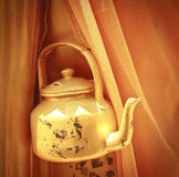 Golden kettle Stock Images