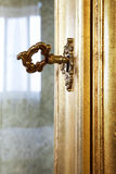 Golden key. In the door a rich furniture Stock Photography