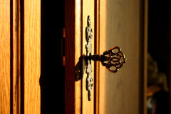 Golden key. Of an old wooden cabinet stock images