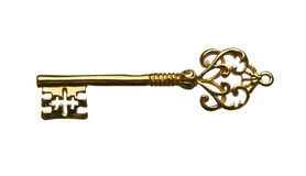 Golden key. Golden skeleton key isolated on white background Stock Photos