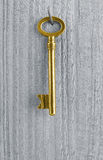 Golden key. On wooden wall - achievement or target concept Stock Photo