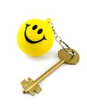 Golden key. On key ring smiles isolated on white background Stock Photography