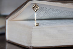 Golden key and a book royalty free stock images