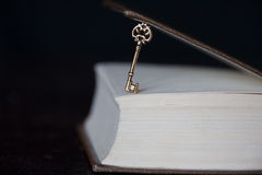 Golden key and a book royalty free stock photography