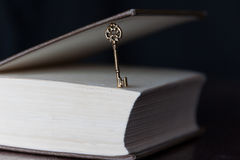 Golden key and a book Royalty Free Stock Image