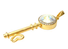 Golden key with brilliants Royalty Free Stock Photography