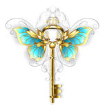 Golden key with butterfly wings. Gold Skeleton Key with gold butterfly wings, decorated with a pattern on a white background Royalty Free Stock Photo