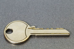 Golden key. A close up of a golden key to happiness Stock Photography