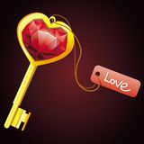Golden key with diamond heart with label Stock Image