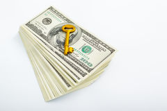 Golden key and dollar Stock Image