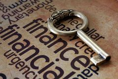 Golden key and finance concept Stock Photos